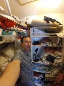 Indie producer Daniel Grossman with his recording kit in a linen closet.