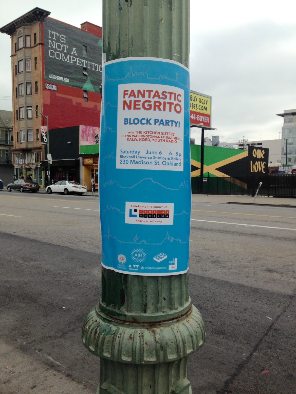 The printed poster, wrapped around a light pole in Oakland.