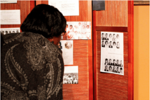 Janice Houstin Nixon looks at yearbook pages from Ensley High School in Birmingham, Alabama, where her sister became the first black student in the school's history.